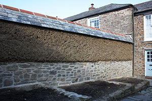 a listed cob wall rebuild new build cornwall