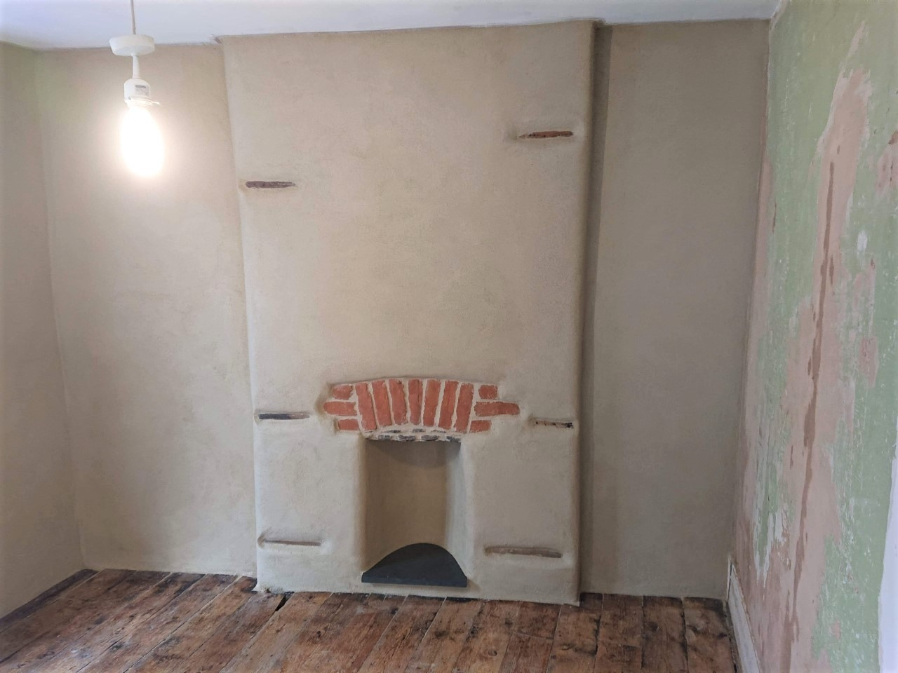 Lime Plastering Fireplace Cornwall